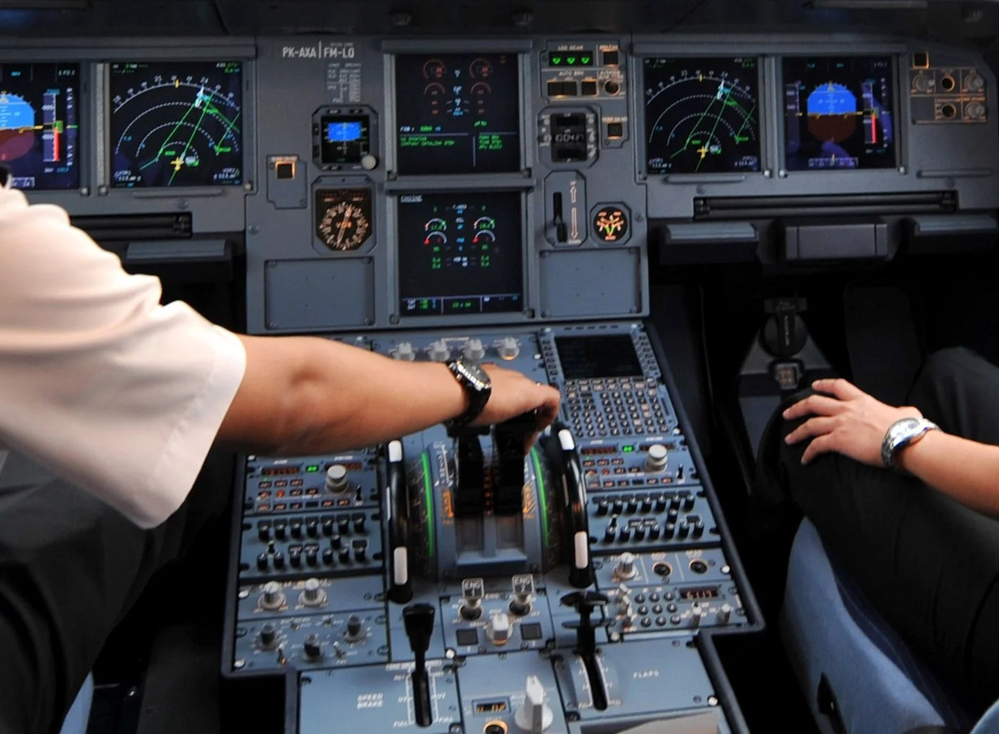 (FILES) - A photo taken on September 24, 2008 shows pilots in the cockpit of an Airbus A320 at Cengkareng airport in Jakarta. One of the two pilots on the Germanwings flight that crashed in the French Alps was locked out of the cockpit before the plane went down, killing 150 people, a source close to the investigation told AFP on March 26, 2015. All 150 people on board, including two babies and 16 German school exchange pupils, died when the Germanwings flight 4U 9525 from Barcelona to Duesseldorf smashed into the mountains after an eight-minute descent. AFP PHOTO / ADEK BERRY (Photo credit should read ADEK BERRY/AFP/Getty Images)