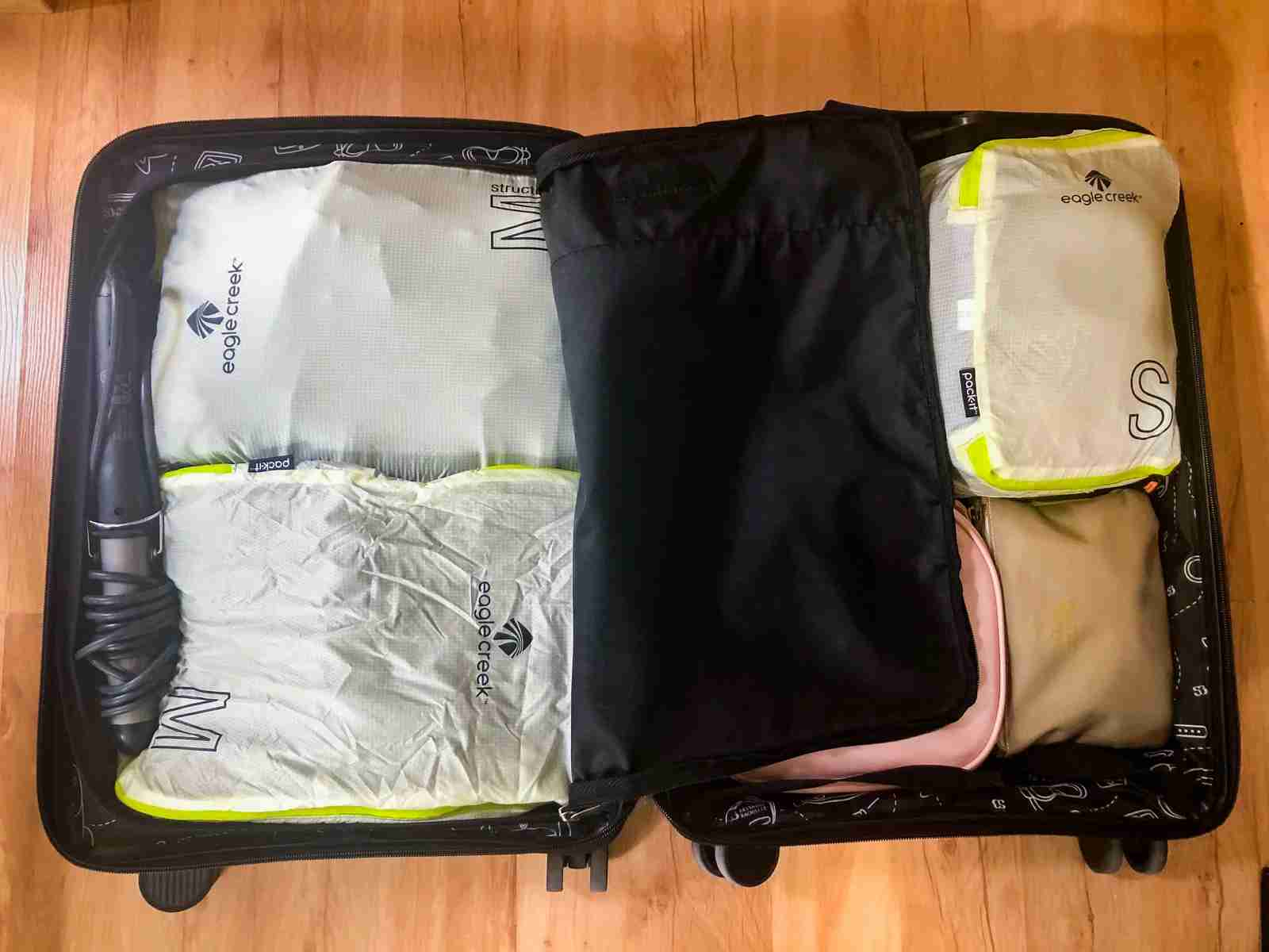 My suitcase stays organized with packing cubes. (Photo by Lori Zaino/The Points Guy)