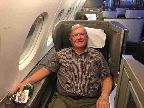 Uncle Peter happily relaxes in British Airways business class.