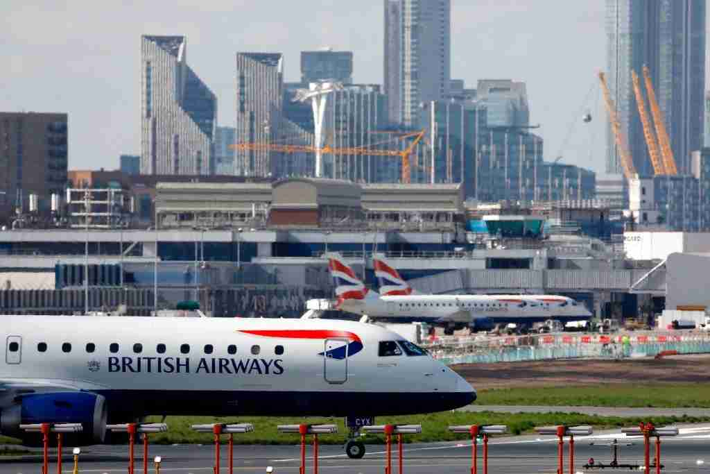 A British Airways plane taxis at the London City Airport, in east London, on March 16, 2020. - IAG, the owner of British Airways and Spanish carrier Iberia, said Monday it would slash the group