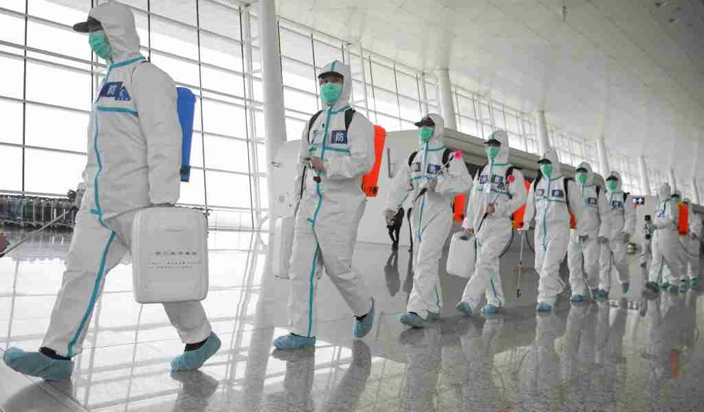 WUHAN, April 3, 2020 -- Firefighters prepare to conduct disinfection at the Wuhan Tianhe International Airport in Wuhan, central China