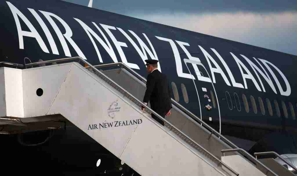 David Morgan, chief pilot at Air New Zealand Ltd., walks onboard a Boeing Co. 787-9 Dreamliner aircraft, operated by Air New Zealand, at Auckland International Airport in Auckland, New Zealand, on Friday, July 11, 2014. Boeing delivered the first 787-9, a stretched version of its marquee Dreamliner, to Air New Zealand, which will be used on the airline's Auckland-Perth route. Photographer: Brendon O'Hagan/Bloomberg via Getty Images