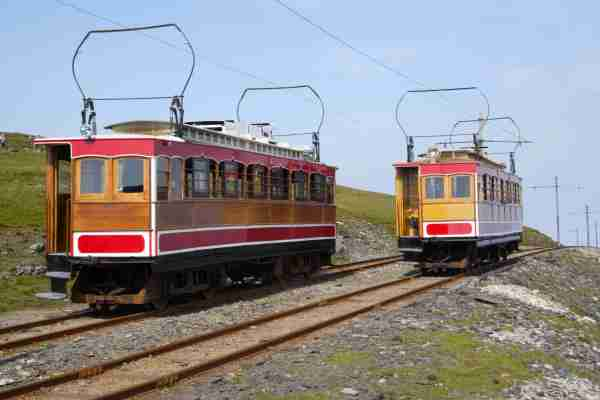 Two trams passing on the Snaefell Mountain Railway, one leaving the summit and the other arriving, Isle of Man, U.K. The summit rises to 2,034 feet and is the highest point in the Isle of Man. Photo by Rosemary Calvert / Getty Images