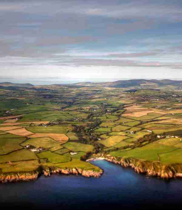 Aerial view of the Isle of Man coastline and fields. Photo by Mariusz Kluzniak / Getty Images