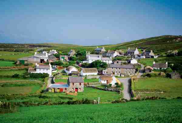 Panoramic view of cottages, Cregnesh, Isle of Man, British Isles. Photo by Medioimages / Photodisc / Getty Images