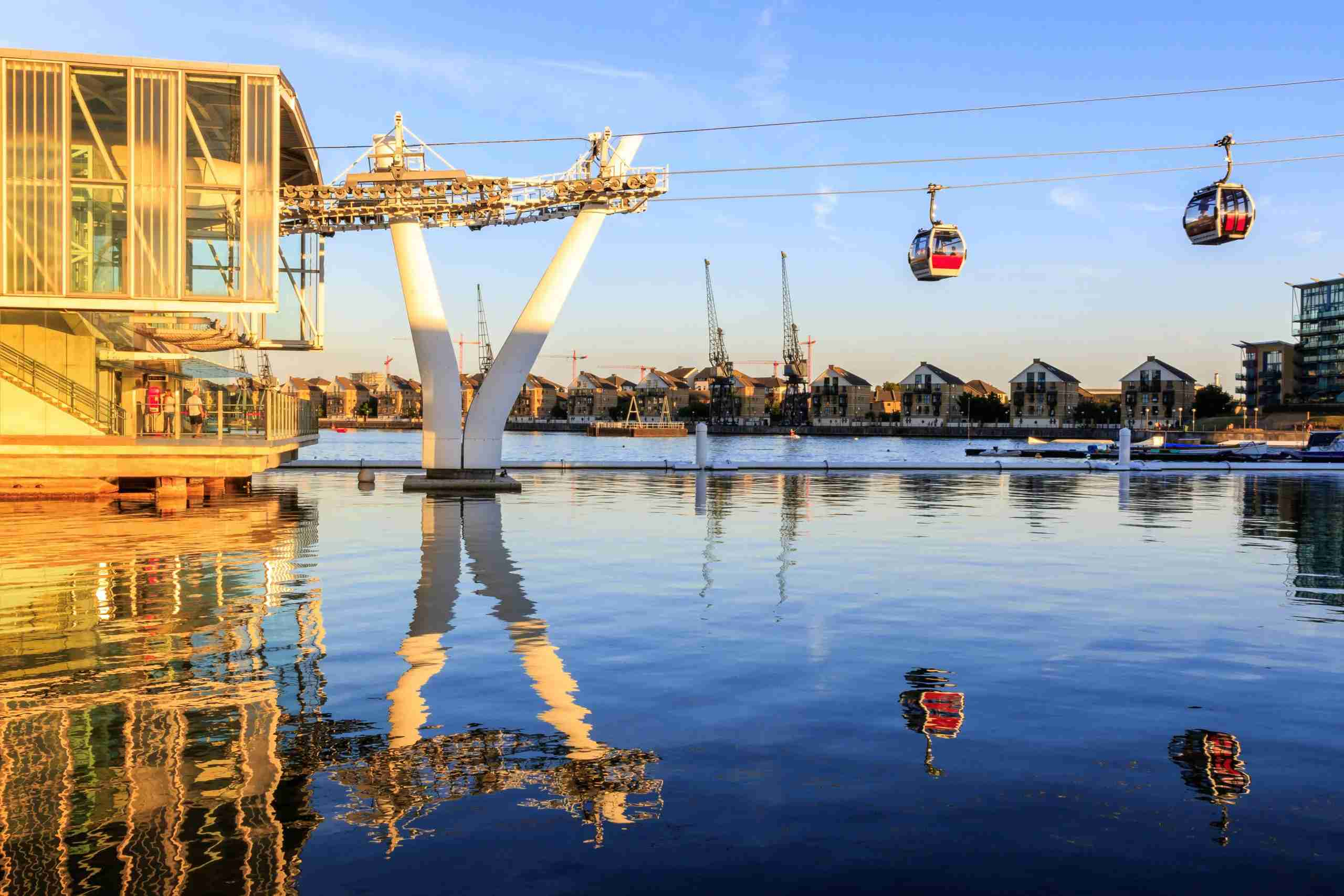 The Thames cable car at Royal Victoria Dock in London at sunset
