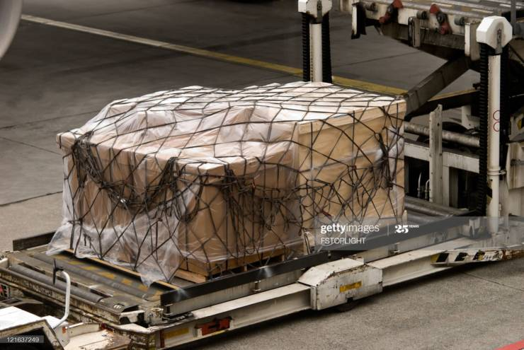 Cargo pallets being loaded into an aircraft (Getty Images 121637249)