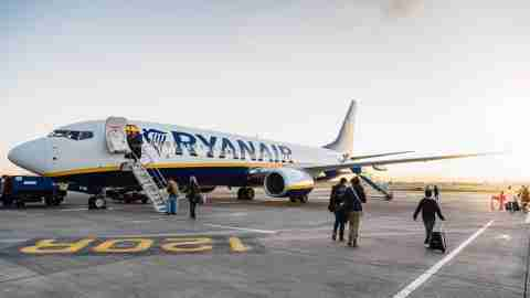 passengers are boarding on ryanair boeing 737 800 airplane in the runway of the dublin airport short t20 bA0bVX scaled