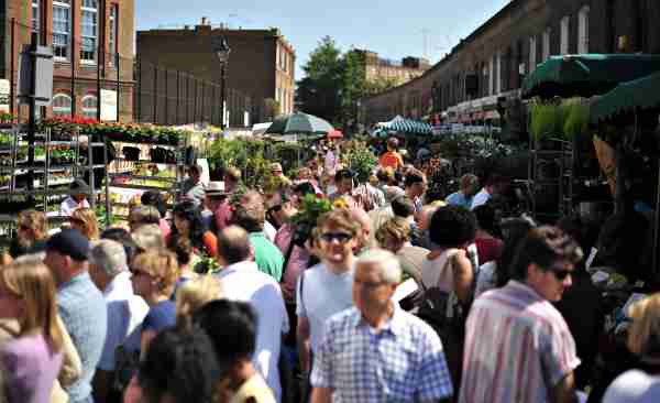 Shoppers fill the Columbia Road flower market