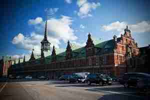 One of the most famous tourist attractions in Copenhagen is the old stock exchange with features the Dragon Spire