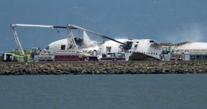 Fire trucks subdue the flames at the Asiana crash scene (AP Photo/Noah Berger).
