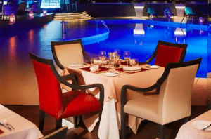 Poolside dining at the Hilton Singapore Hotel.