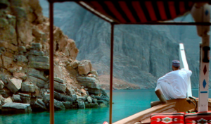 In Oman, I'd love to glide down a mountain-rimmed sea channel on an ancient boat called a dhow