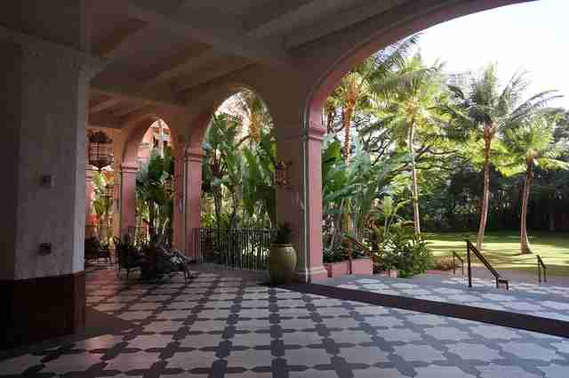 The graceful tiled porch of the Royal Hawaiian Hotel