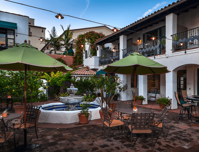 A lush garden courtyard lies at the center of the Spanish Garden Inn