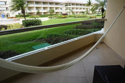 The ground level courtyard view from the spacious patio with hammock