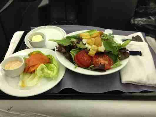 The starter with smoked salmon and a salad.