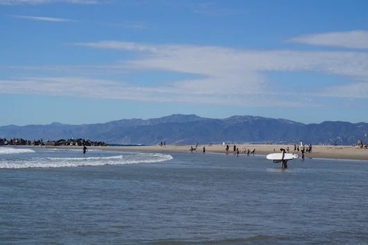 View of the Santa Monica Mountains from the Venice Beach Breakwater. Photo by Shayne Benowitz.