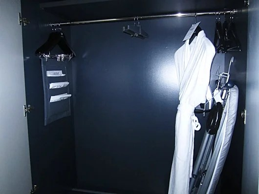The ironing board inside the closet