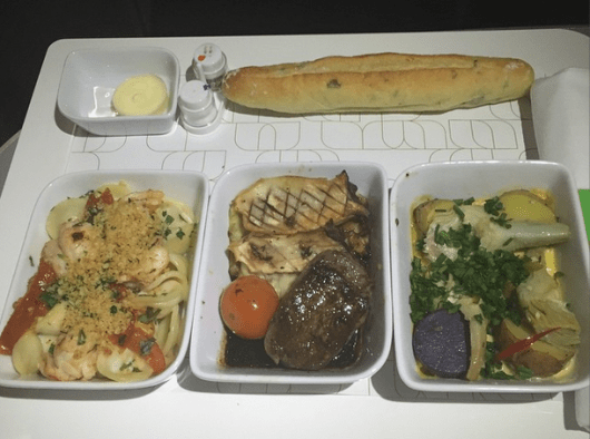 Choose three out of five tapas-style entrees to customize your in-flight meal in Mint.