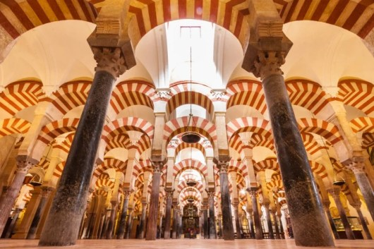 Cordoba's mosque has hundreds or arches. Photo courtesy of Shutterstock.