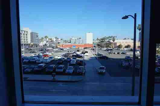 A disappointing view of the surface parking lot across the street.