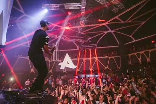 Afrojack shares a champagne shower.