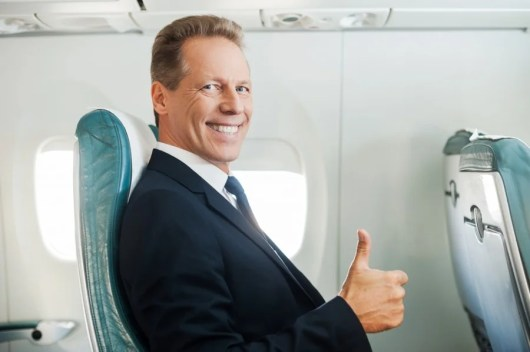 This dude flew nonstop on off peak dates, and look how happy he is! Photo courtesy of Shutterstock.