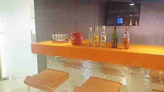 A bar with rum and an icebox containing no ice