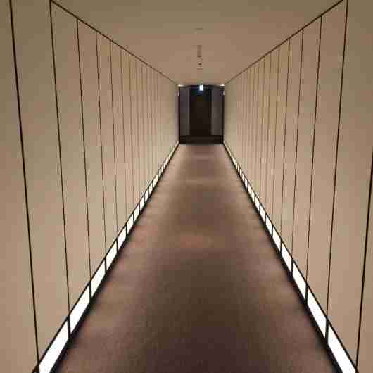 The guest hallways at the Andaz Tokyo are long, sleek and quiet.