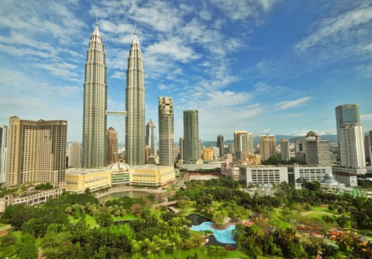 Kuala Lumpur is home to tropical parks and soaring skyscrapers—like the PETRONAS Twin Towers. Photo courtesy of Shutterstock.