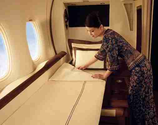 Turndown service includes making up the bed with Givenchy linens. Photo courtesy of Singapore Airlines.