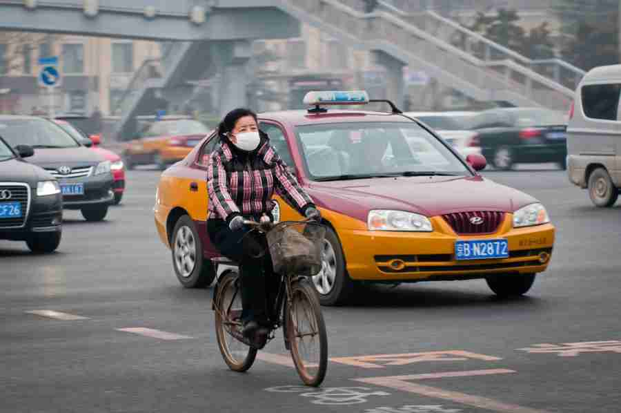 A local Beijing resident wears a mask to block out the city