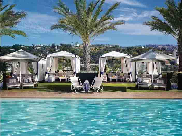 Luxury cabanas & panoramic views at the London West Hollywood rooftop pool.