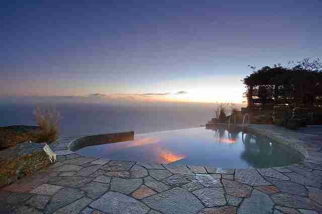 Enjoy this pool-esque jacuzzi overlooking the Pacific Ocean.