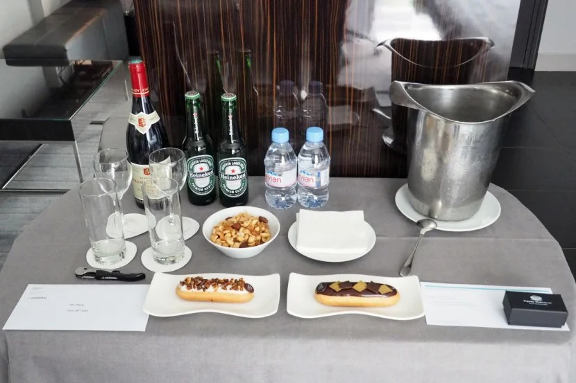 SPG ambassador amenity, including red wine, two beers, nuts and eclairs.