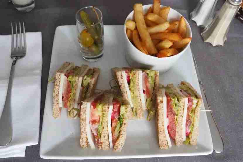 Room-service vegetarian club sandwich.