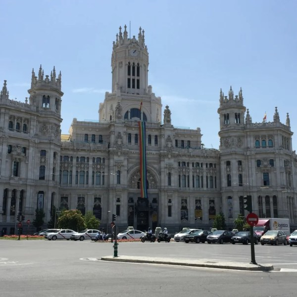 The City Hall in Madrid adorned with a giant rainbow banner.