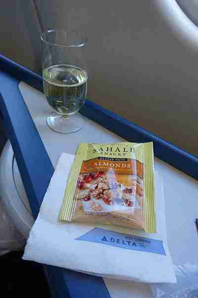 Champagne and a snack bag of almonds.