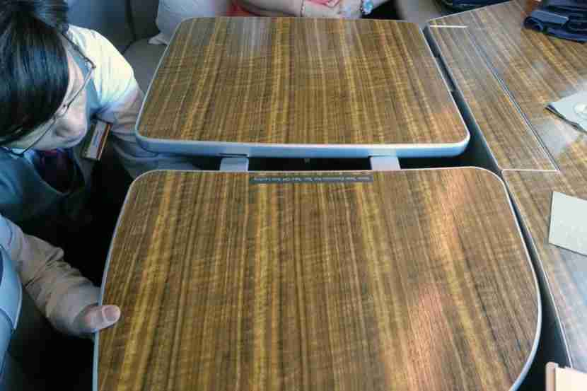 Flight attendants can install a table extender so you can dine with a companion.