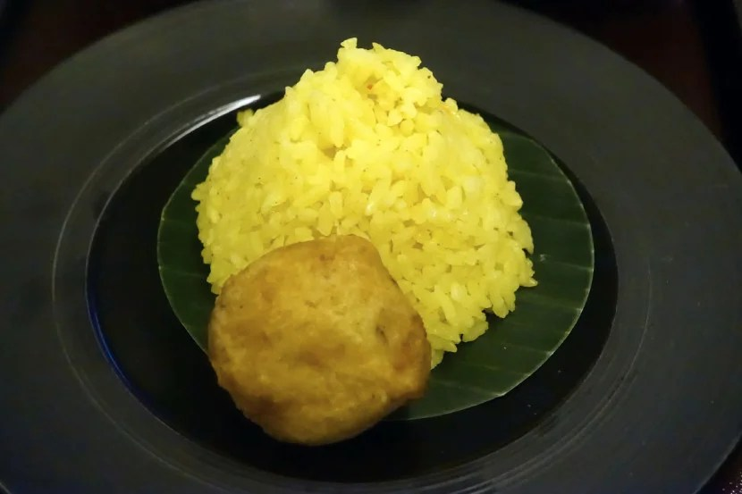 Yellow rice and a potato dumpling.