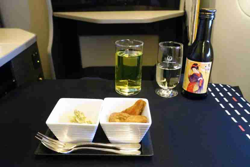 The amuse bouche with a glass of sake.