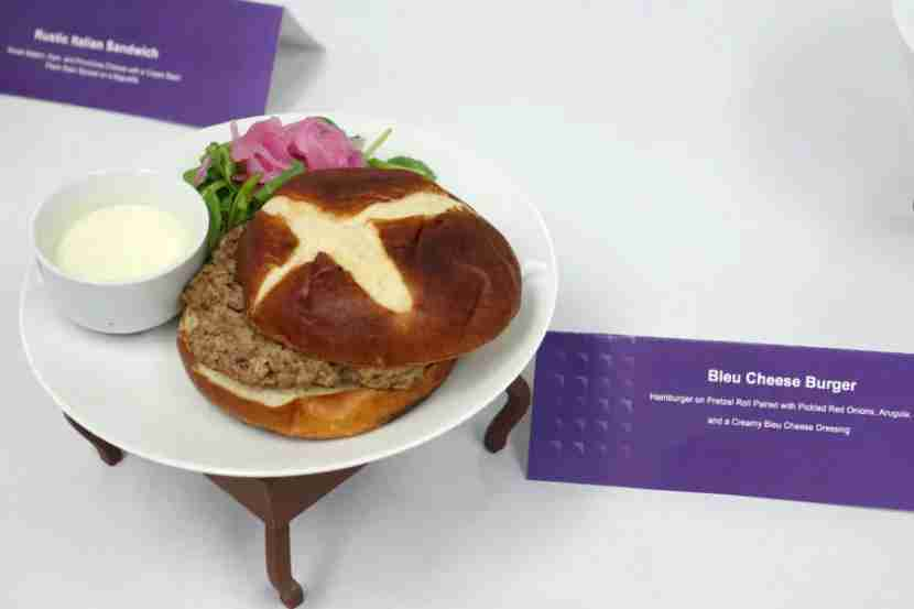 Bleu cheese burger on a pretzel roll.