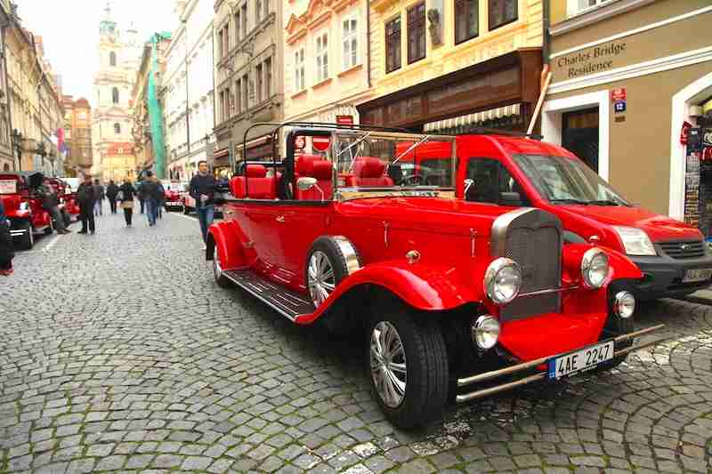 Vintage cars provide both sightseeing tours and Old Town eye candy.