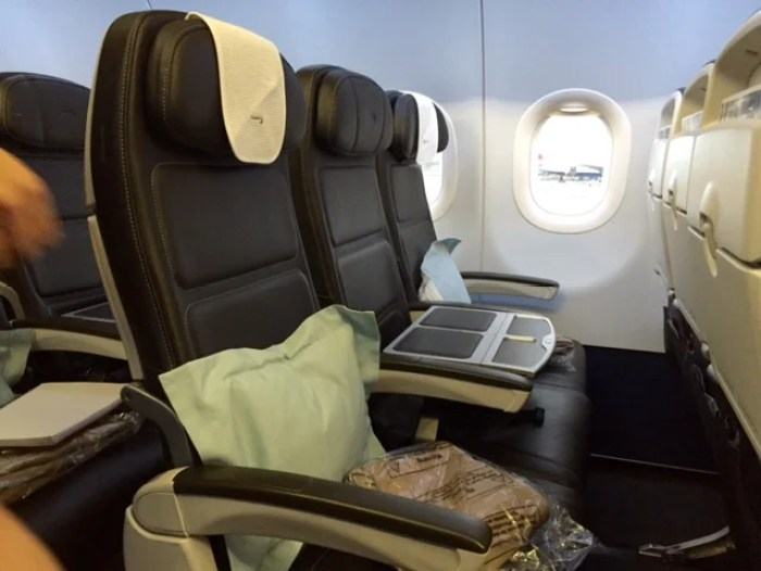 In BA short-haul business class, a tabletop insert blocks the middle seat.