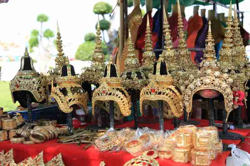 Gilded head dresses and other accoutrements are key to the traditional Thai culture.