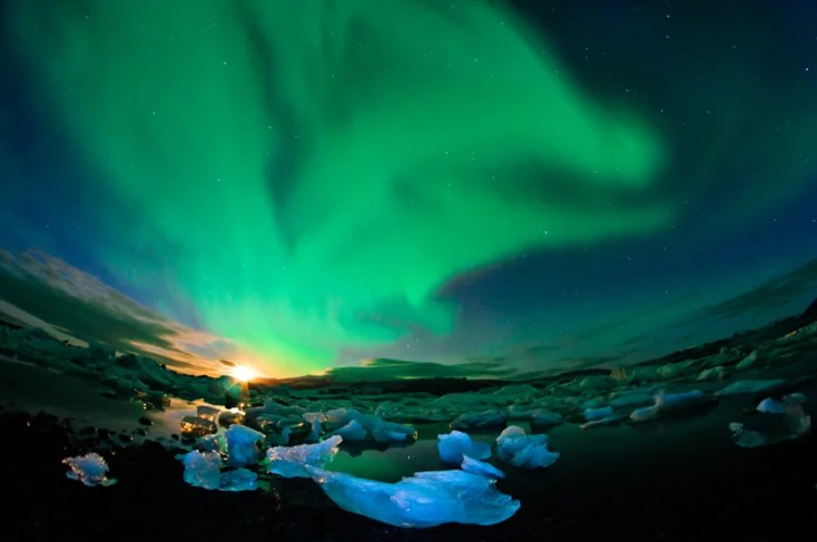 The Aurora is commonly visible over shards of ice that dot the coastlines and inland lakes of Iceland. Photo courtesy of Shutterstock.