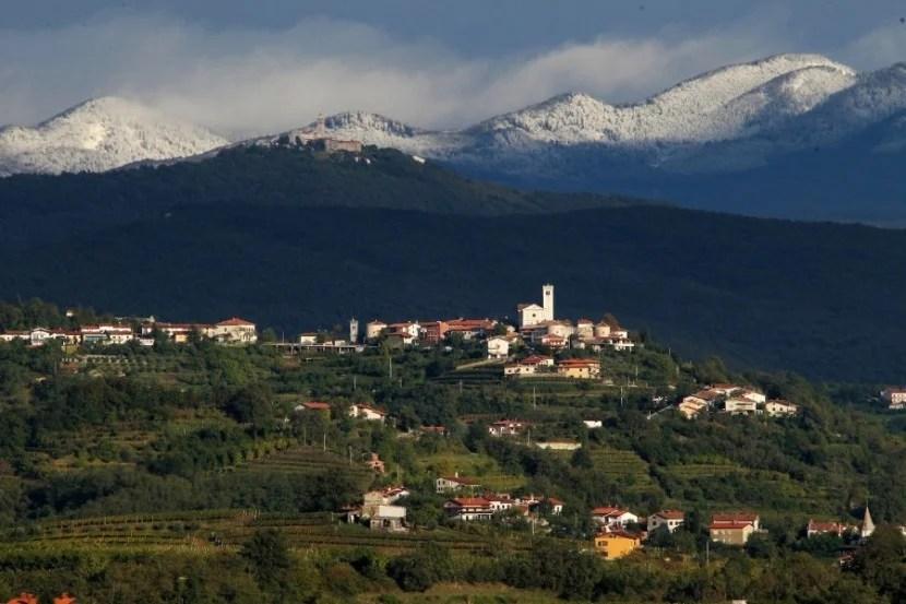 The mountain-fringed vineyards of Slovenia's Goriska Brda region. Photo by Ales Fevzer, courtesy of Slovenia Tourism.