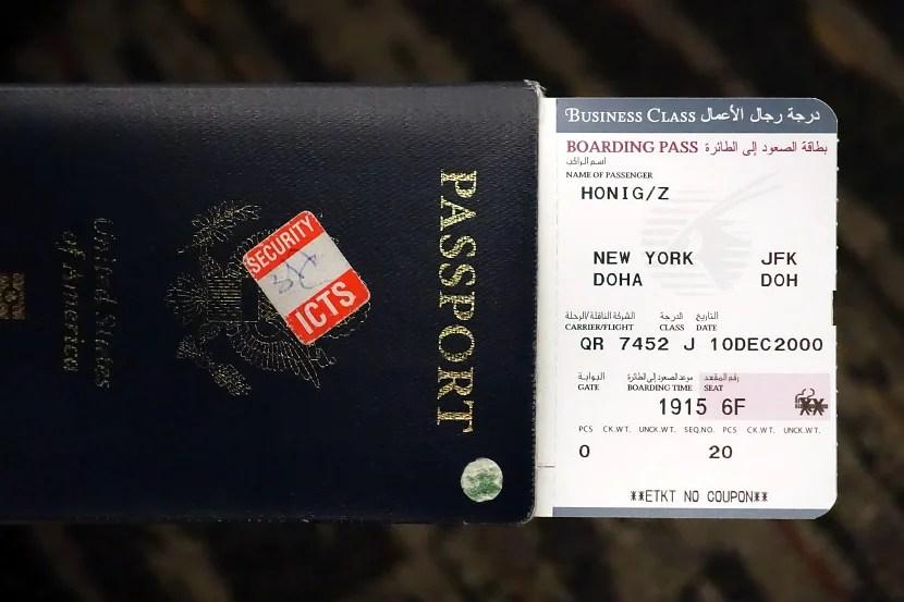 Boarding pass for QR flight 7452.