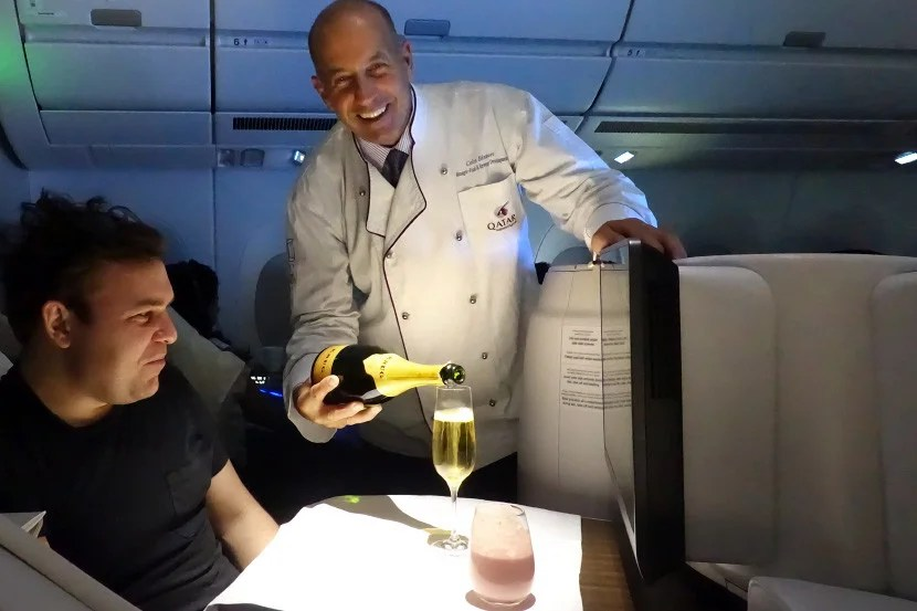 Qatar's F&B manager serving Krug on the flight.